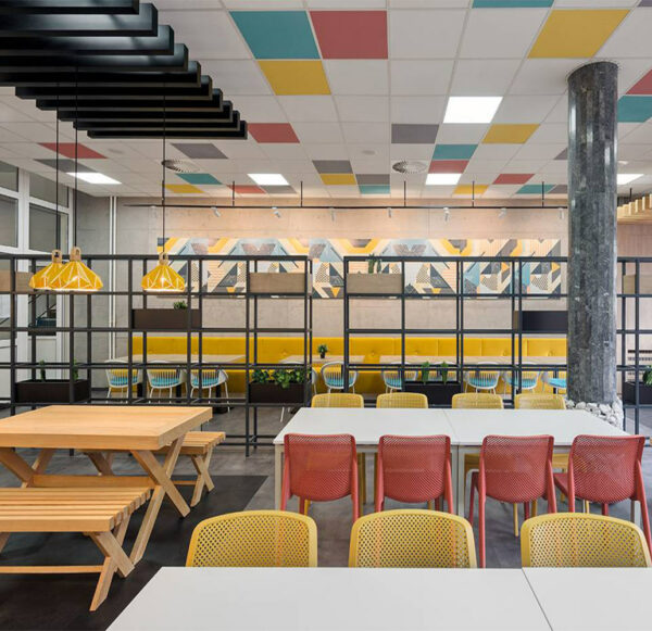 Indoor cafeteria with NARDI Bit Chairs in Coral Red & Mustard Yellow