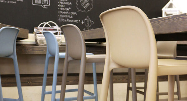 NARDI Faro Breakfast Bar Stools at wooden bench in an indoor cafe