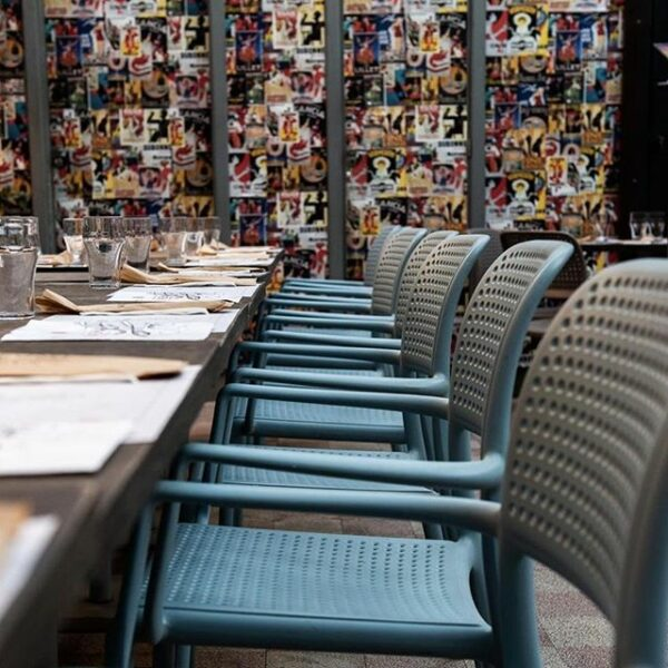 NARDI Bora Arm Chairs in Taupe lined up in restaurant