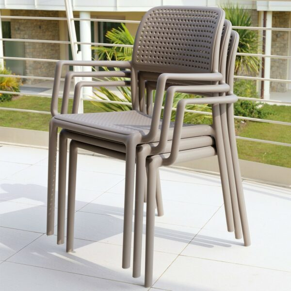 NARDI Bora Arm Chairs in Taupe stacked together on balcony