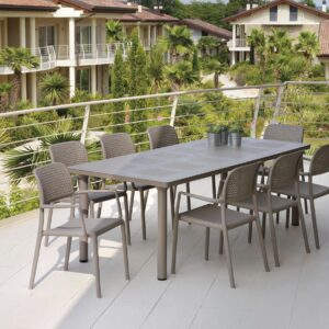 Levante 7 Piece Dining Set NZ - Extended to accommodate 8 chairs in Taupe on a deck