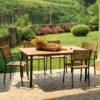 Artica Rattan Dining Chairs – Straw Colour & Charcoal Legs in a Patio Setting