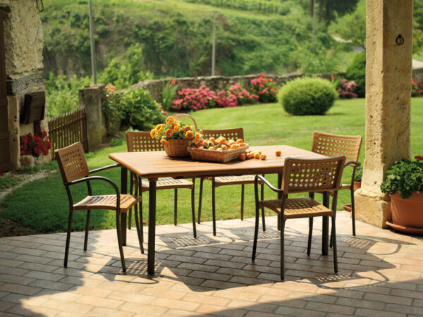 Artica Rattan Dining Chairs - Straw Colour & Charcoal Legs in a Patio Setting