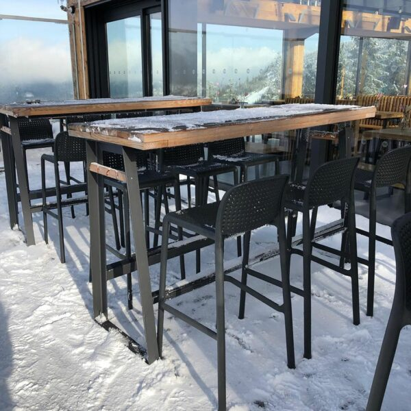 NARDI Lido Tall Outdoor Bar Stools in Charcoal at ski resort café in snow
