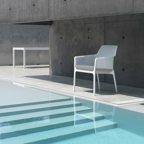 The NARDI Net Relax Lounge Chair in White with Grey Cushions next to pool