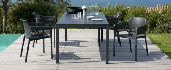 NARDI Net Chairs and Rio Table Set - Charcoal on Deck next to Pool