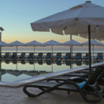 NARDI-Alfa-Sun-Loungers-in-Charcoal-lined-up-by-hotel-pool