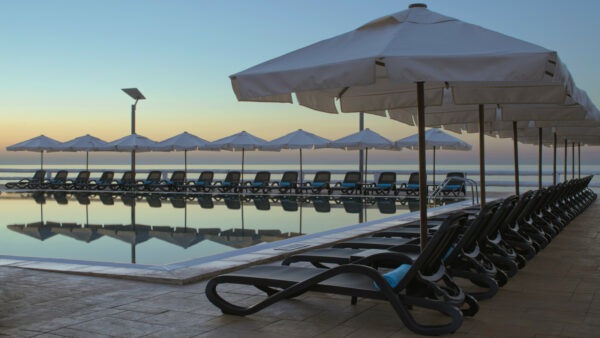 NARDI Alfa Sun Loungers in Charcoal lined up by hotel pool