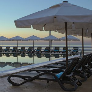 Alfa Sun Loungers NZ - Pictured in Hotel Poolside Setting