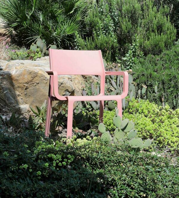 NARDI Trill Armchair (Rosa Pink) in garden with rocks and succulent plants