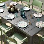 Trill Armchairs & Rio Alu 210-280 Extendable Outdoor Table set with cutlery and plates for dining