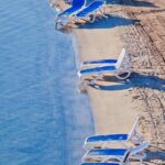 Omega Sun Loungers in Blue & White – Pictured on Beach by the Ocean