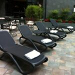 Omega Sun Loungers in Charcoal – Pictured on Hotel Patio next to Pool