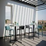 Trill Tall Bar Stools on sunny outdoor balcony in Charcoal and Teal