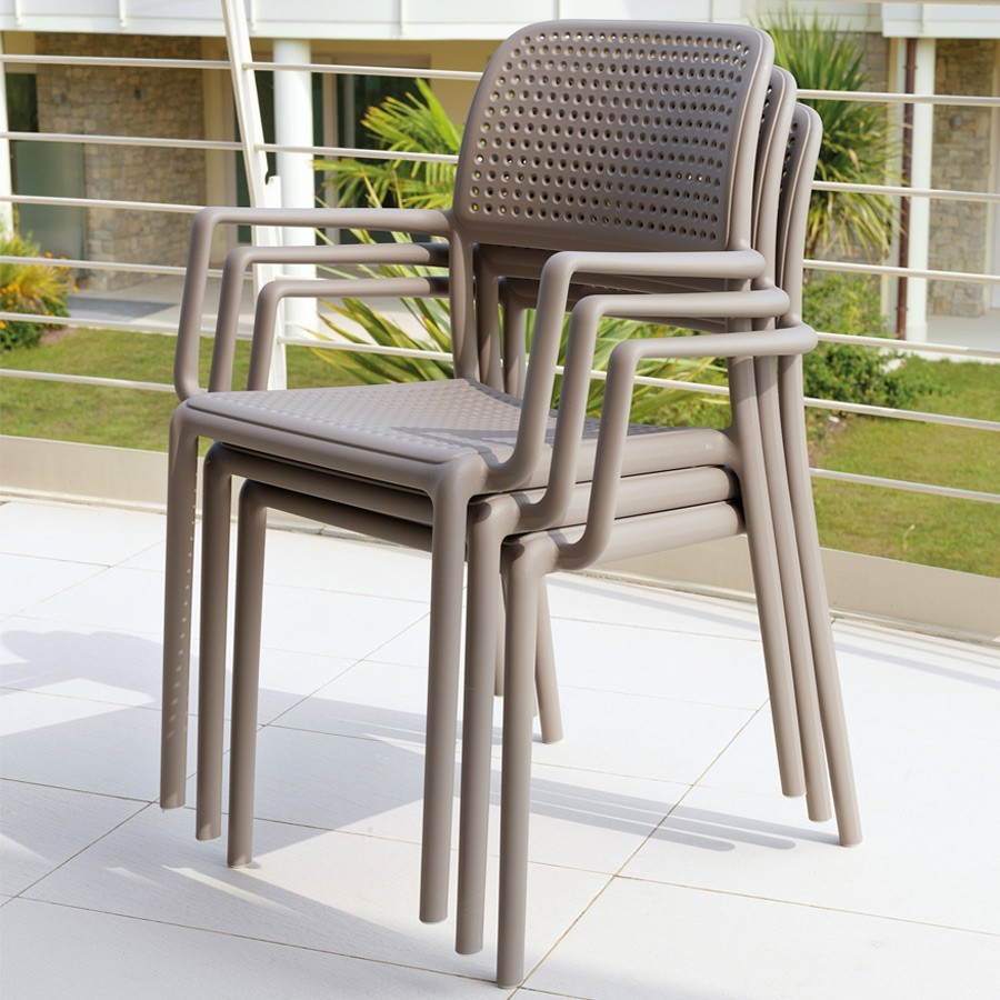 Bora Arm Chairs in Taupe - Pictured Stacked on Balcony