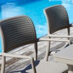 Bora Arm Chairs in Taupe – Pictured in Dining Setting by the Pool