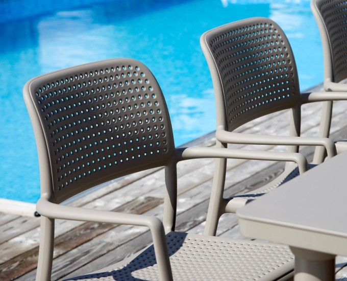 Bora Arm Chairs in Taupe - Pictured in Dining Setting by the Pool