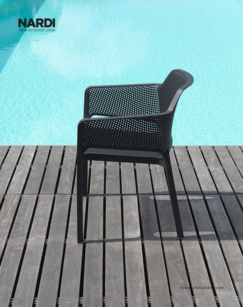 Net Chair in Charcoal – Pictured on Deck next to Pool (Side View)