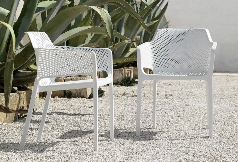 Net Chairs in White – Pictured on gravel patio area