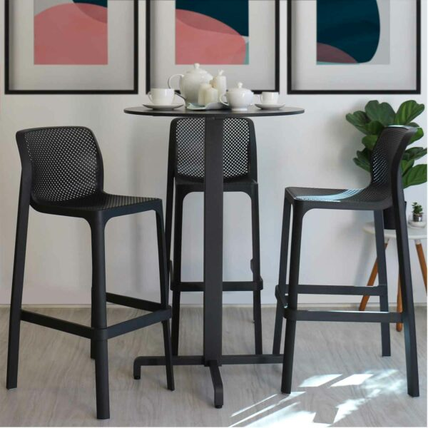 NARDI Net Tall Bar Stools in Charcoal around an Indoor Bar Leaner