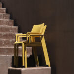 Trill Armchairs in Mustard – Pictured Stacked on Outdoor Staircase