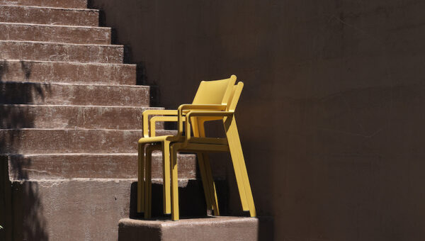 Trill Armchairs in Mustard - Pictured Stacked on Outdoor Staircase