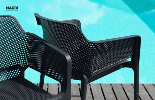 Two Net Chairs in Charcoal - Pictured on Wooden Deck next to Pool