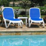 Omega 3-Piece Sun Lounger Set (Blue & White) side of residential pool