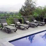 Omega 3-Piece Sun Lounger Sets on wooden deck next to pool