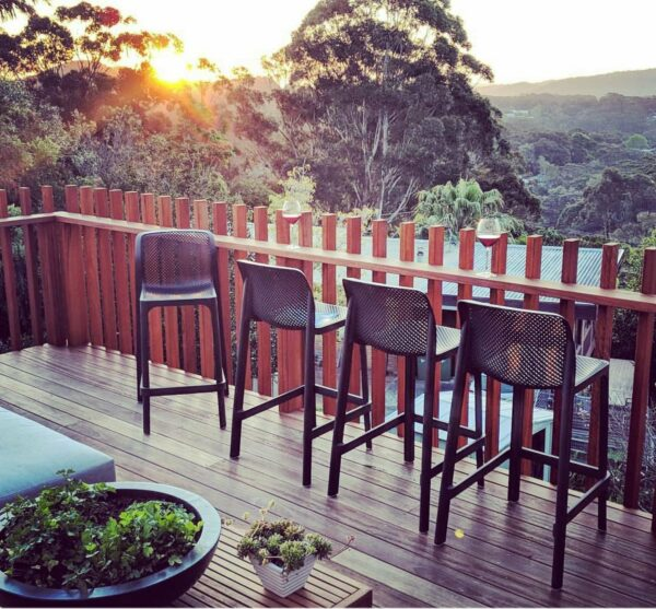 NARD Net Kitchen Counter Stools in Charcoal Outdoors on Deck at Sunset