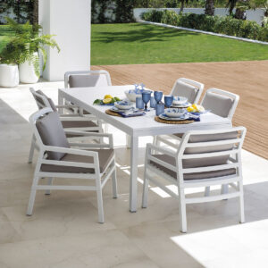 The Aria Rio 7 Piece Outdoor Dining Setting (White Table and White Chairs with Grey Cushions)