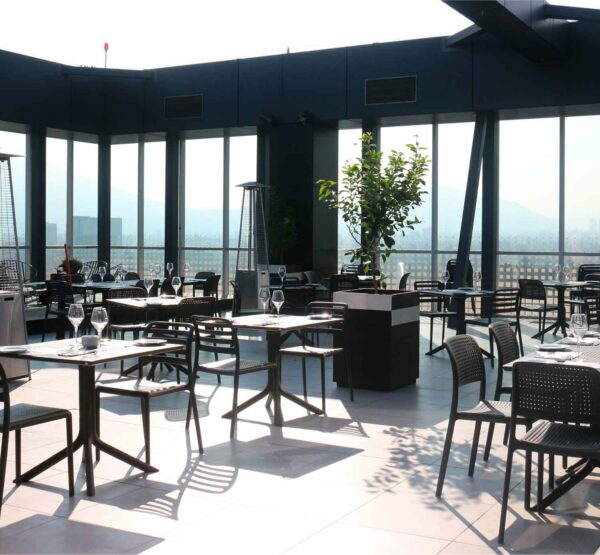 The Costa Clip 3 Piece Balcony Set in a Restaurant Setting
