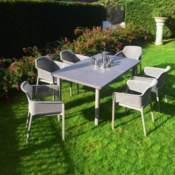 The Net Levante 7 Piece Dining Set in Taupe Pictured in a Garden Setting
