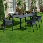 The Net Levante 7 Piece Dining Set in Charcoal Pictured Outside a Country Home Garden