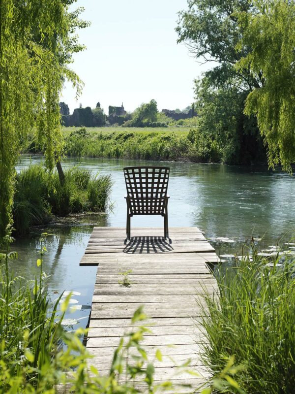 NARDI Folio Deck Chair (Tobacco Colour) on jetty overlooking river