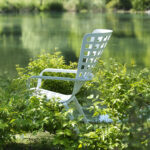 NARDI Folio Deck Chair in White between garden plants