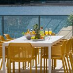Rio ALU Net 10-Seater Outdoor Dining Set – White & Mustard (Outdoors on Deck)