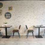 Aviator Mid-Century Modern Dining Chairs Along Cafe Wall
